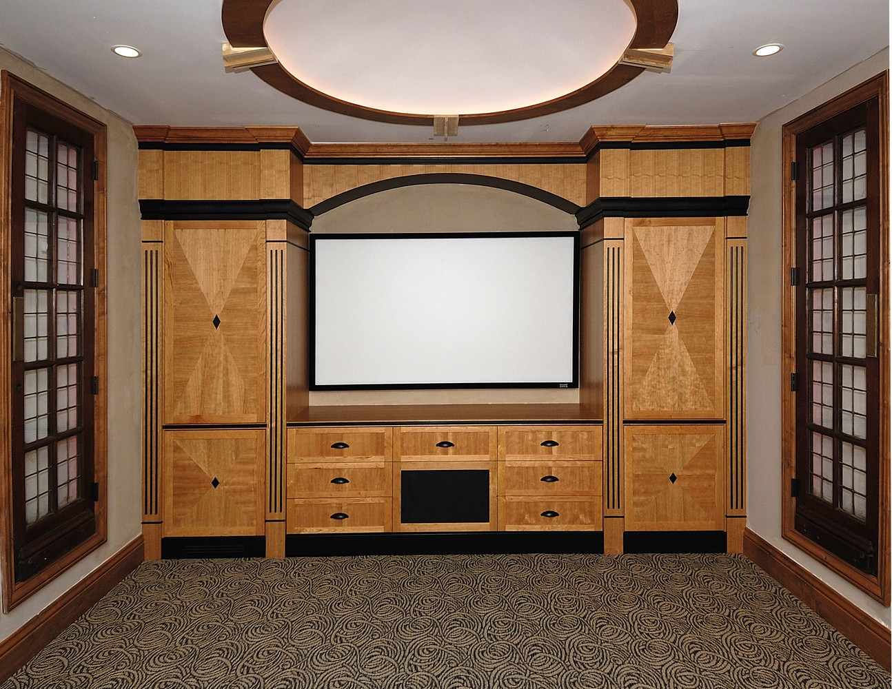Cherry wood Home Theater cabinet with starburst door panelsTV Media Cabinetry   Unique Design Cabinet Co. Home Theater Cabinet Design. Home Design Ideas