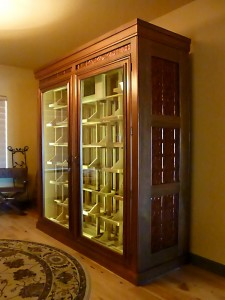 Self contained wine cooler. Alder with tin ceiling panel inserts.