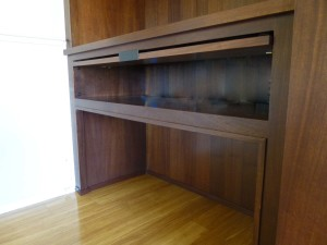 Mahogany niche inset cabinets with LED illumination
