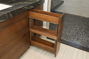 Dovetailed vertical drawers with adjustable shelf for tall bottles